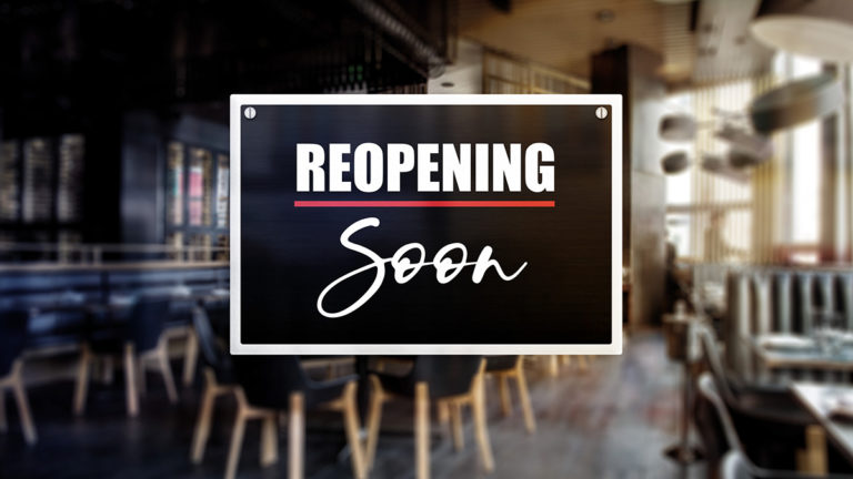 Reopening soon sign in front of an empty restaurant shown blurred in the background illustrates business downtime in the wake of a disaster and the urgency to recover as soon as possible.